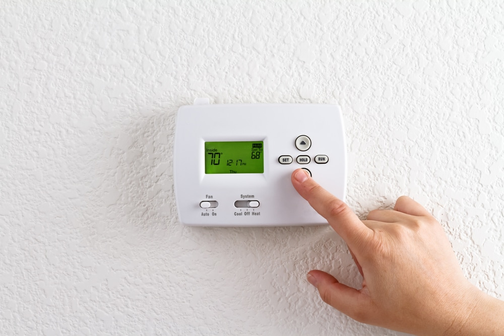adjusting thermostat because you need heating repair