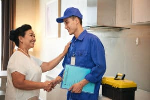 Woman thanks licensed plumber for his work